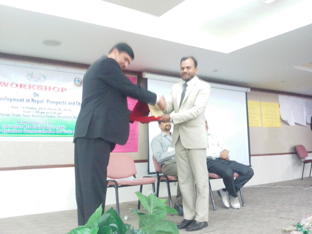 President of Floriculture Association of Nepal Mr. Lokonath Gaire is handing over a Crest to us as a special guest of intl. Workshop on Floricultural business in Nepal - Prospect & Challenges